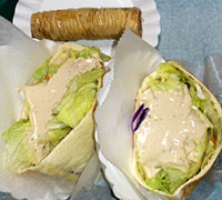 Falafel sandwiches. Word on the street is that if you get the 2 regulars, its bigger than the large. Platter looked FAB!